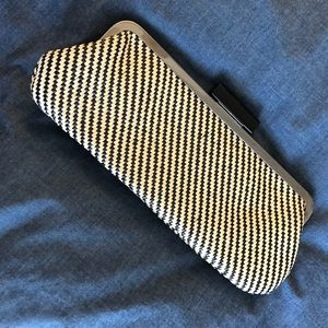 Textured black and white clutch